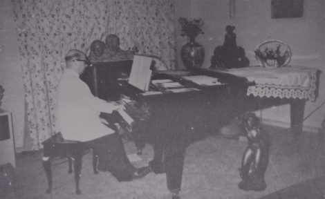Camille Gheysens composing, 1950s (?)